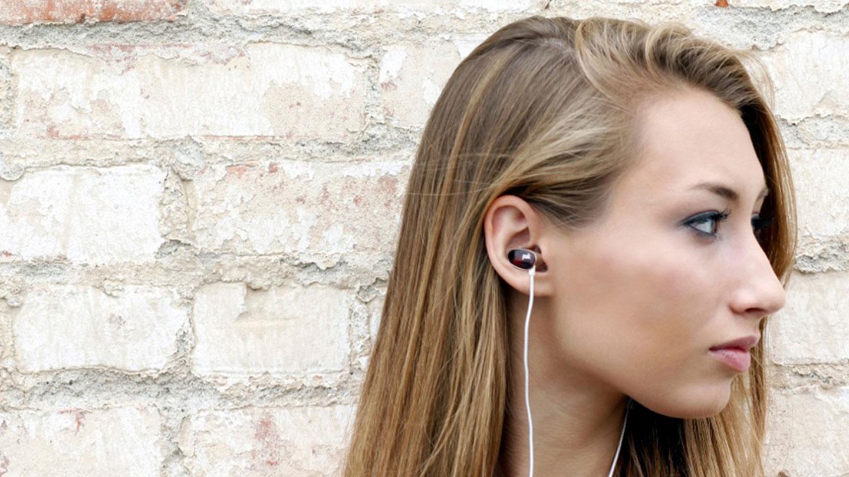Girl listening on Spooners earbud