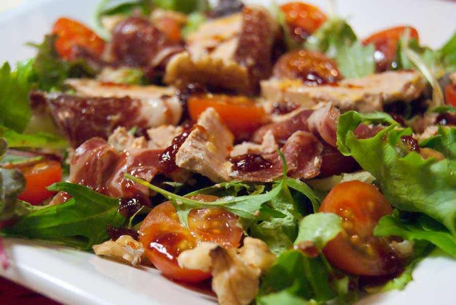 Gourmet summer salad with foie gras and Iberian ham