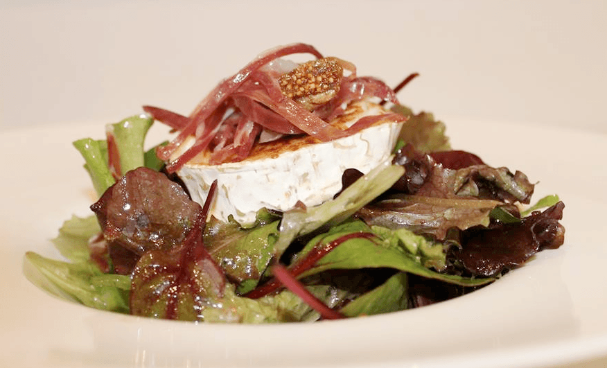 Caramelized goat cheese salad with Jamon Iberico de Bellota