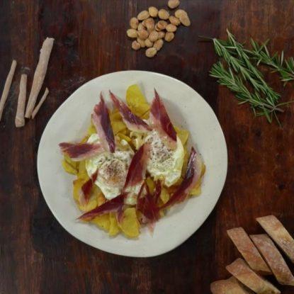 Potatos with eggs and Jamón Ibérico de Bellota. Spanish dish