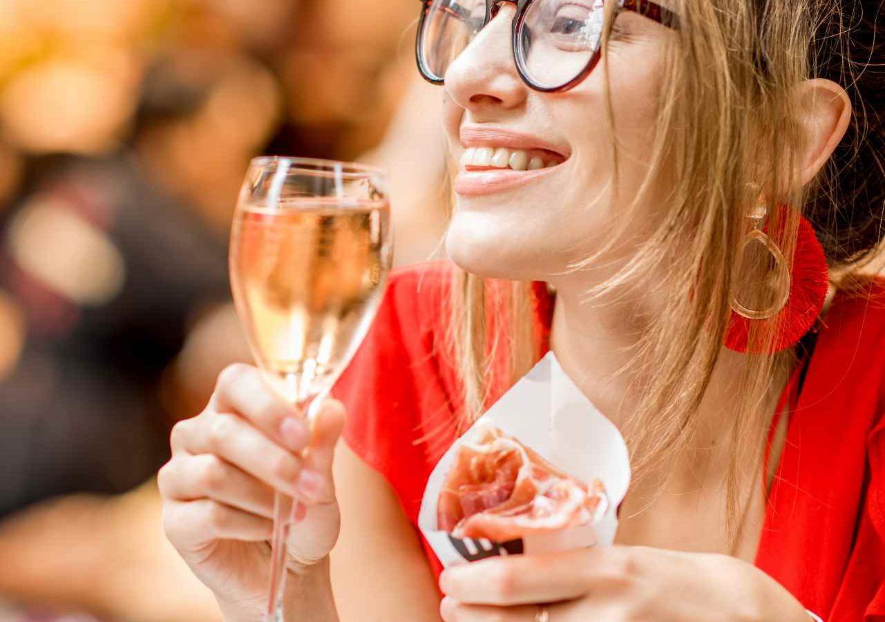 Woman enjoying Spanish Tapas in Barcelona