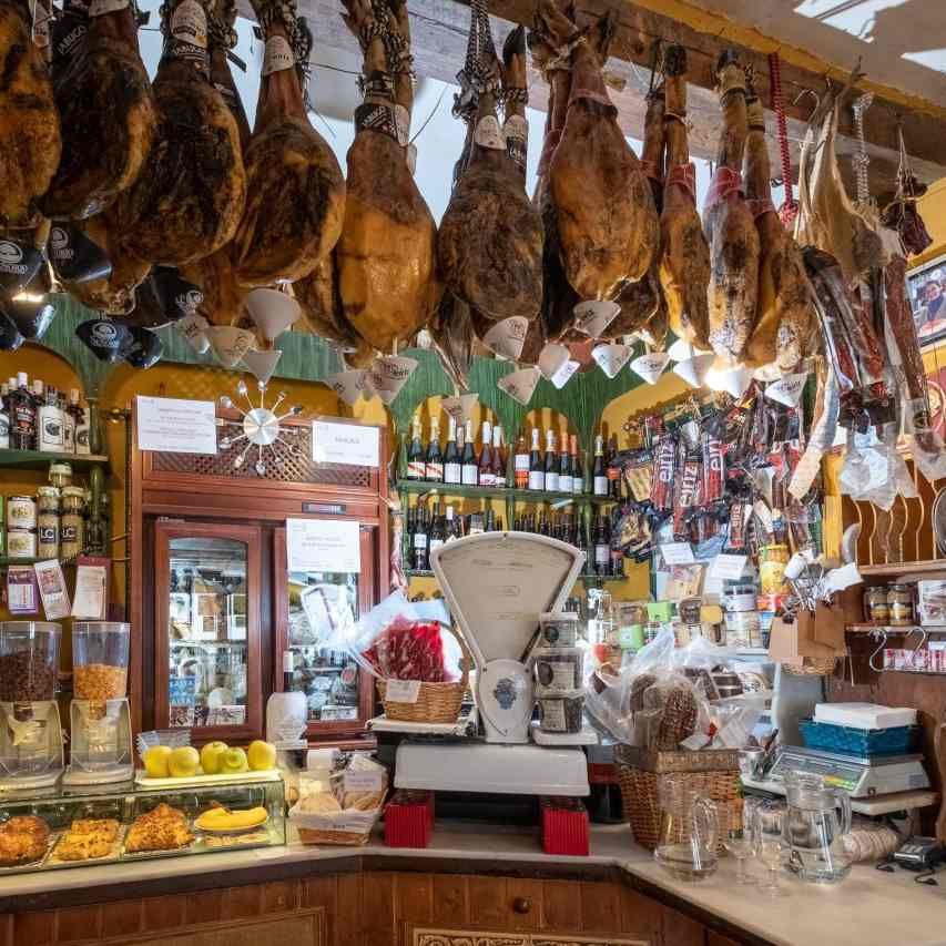 Amazing Tapas Bar in Seville with hanging jamones