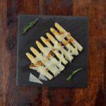 Premium white asparagus with garlic and manchego cheese. Spanish Tapa