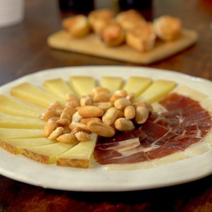 The perfecft plate of Jamón Iberico de Bellota and Manchgego cheese with Picos camperos and marcona almonds