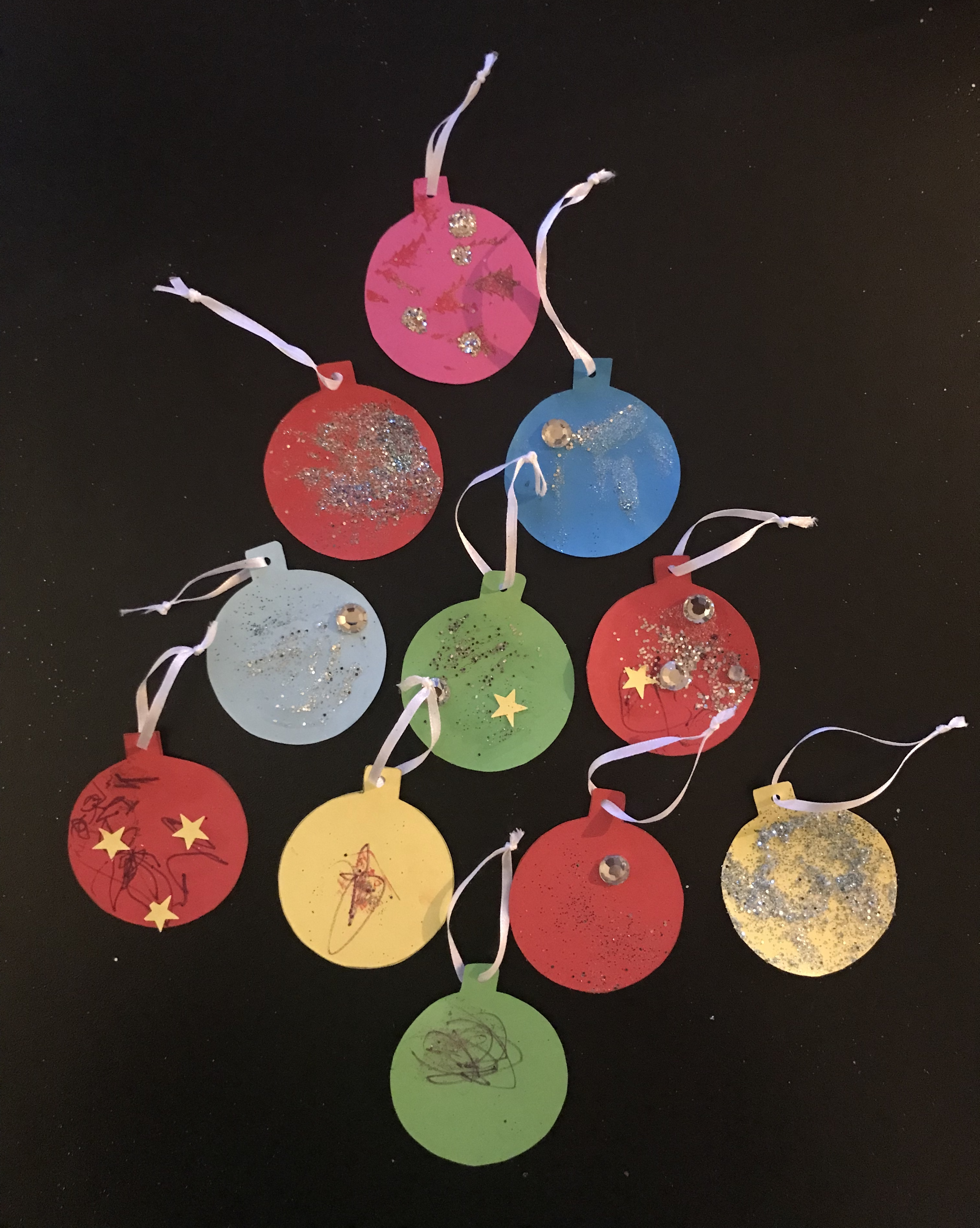 Completed Christmas tags layed out in the shape of a tree