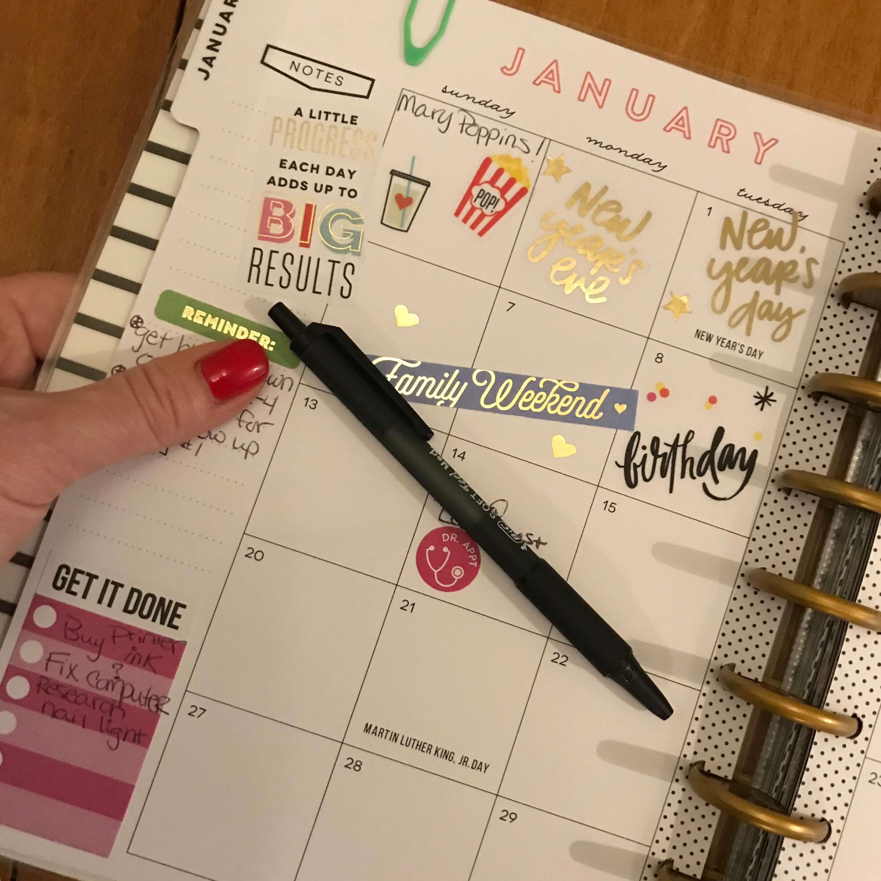 First page of a Happy Planner monthly planning with stickers and important dates filled in