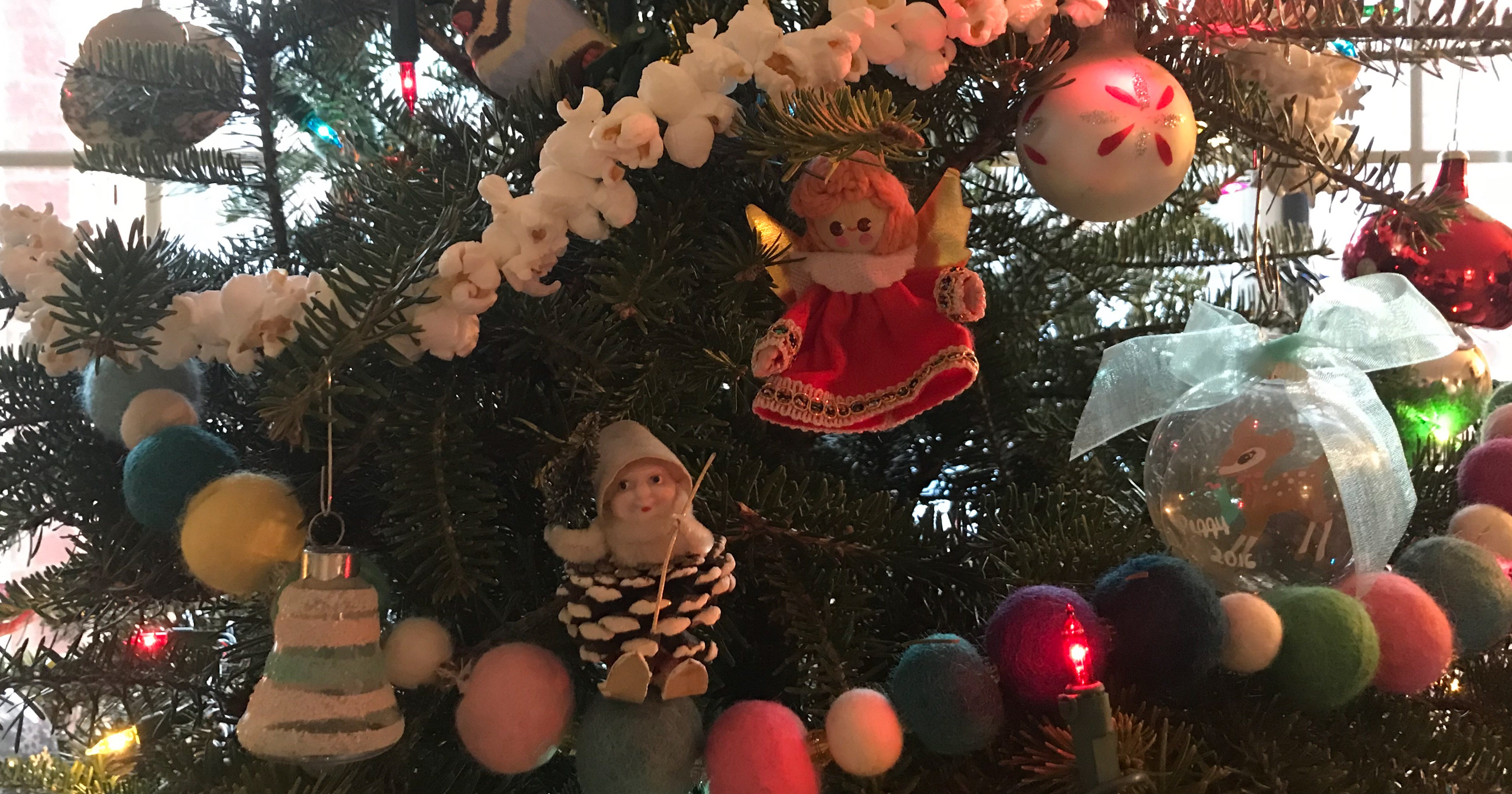 Christmas tradition of decorating the tree with collected ornaments