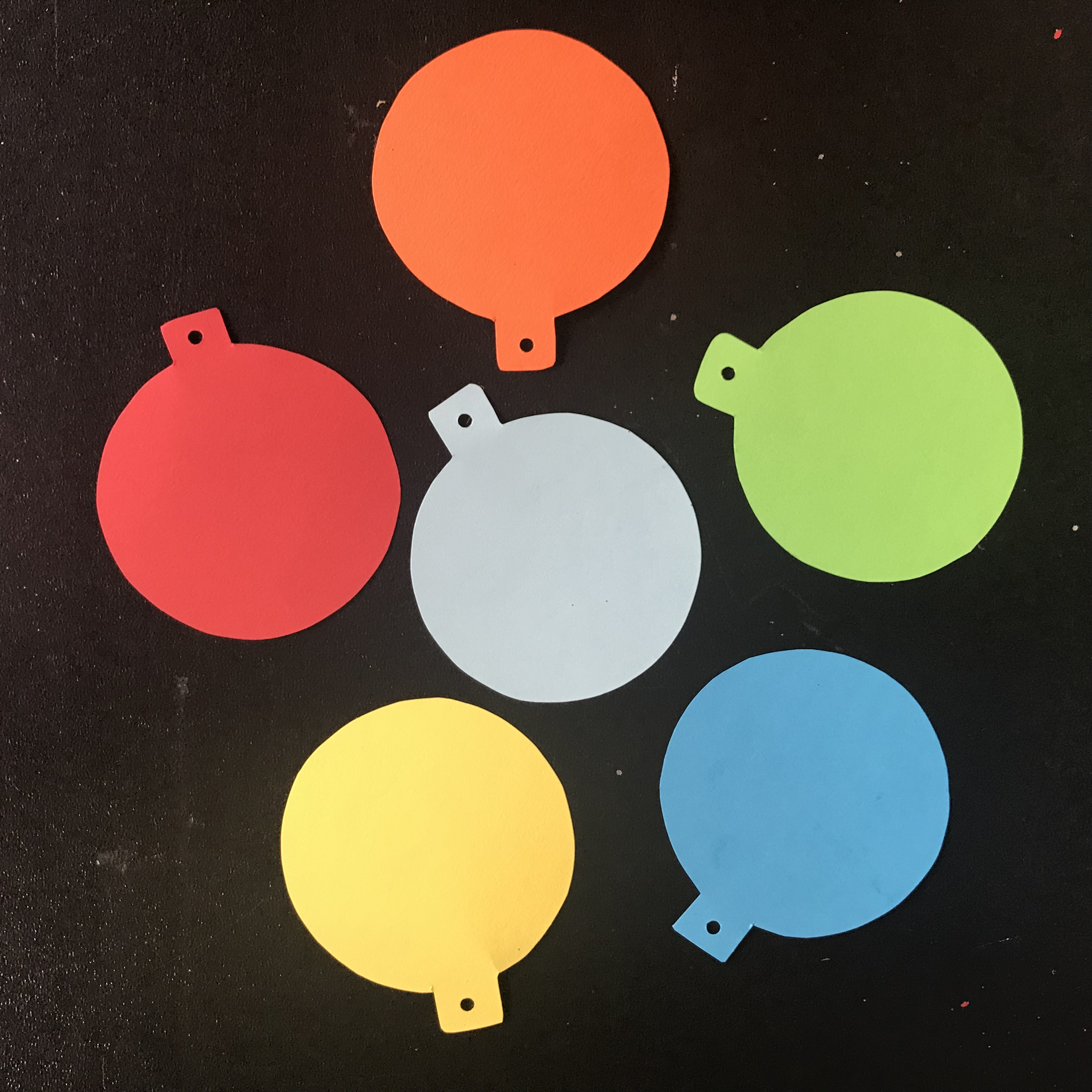 Ornaments cut out of various colors of card stock