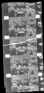 Frames from a film show two men