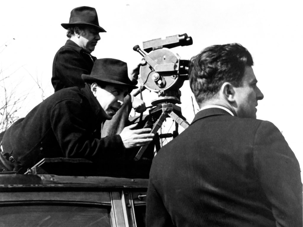 Three members of movie crew and camera