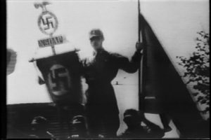 Nazi brown shirt holds flags