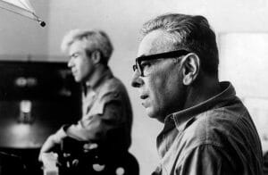Two men in profile look intently