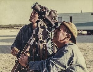 Two men filming with 16mm movie camera