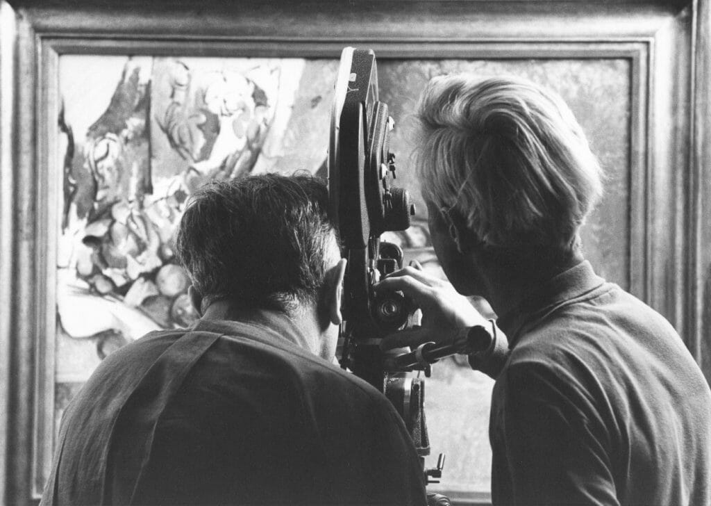 two men, backs to camera, film painting