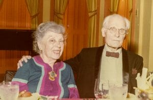 Man and woman, elderly, pose for camera
