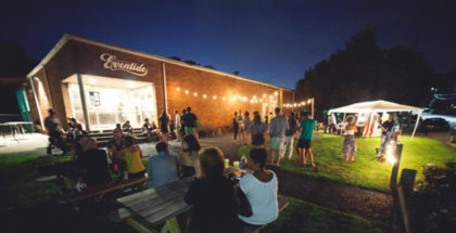 Eventide Brewing outside tables night