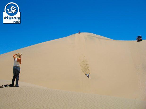 Sandboard in Usaka Desert in Nazca Valley.