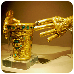 Gold Museum Glass and hands