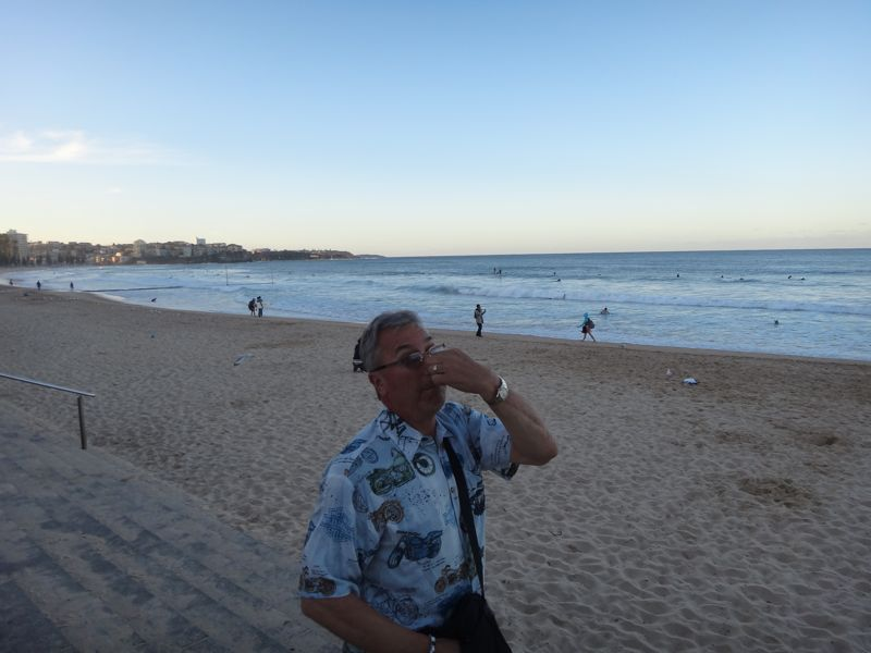 Roger is NOT reacting to the beach, but to the overwhelming smell of fish and chips frying