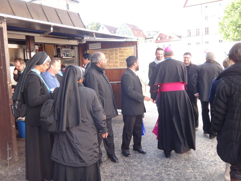 Monsignor greets in Regensburg