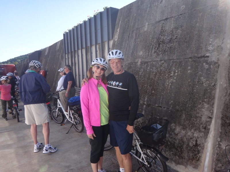 Us at bike ride, (wall in background)