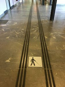 Slightly raised 'tracks' by which blind people can negotiate the train station