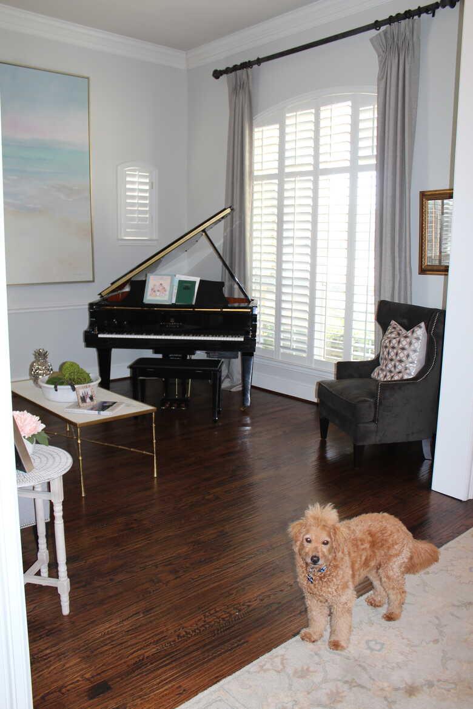 Beautiful, high polished, black Baby grand player piano