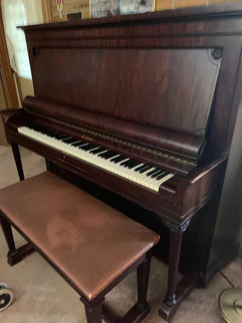Beautiful antique mahogony Piano and matching bench