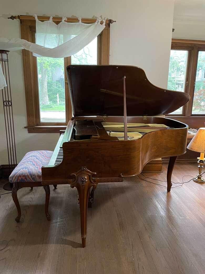 beautifully carved baby grand