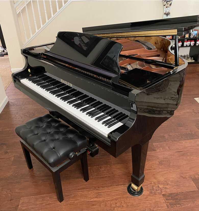 Hailun Baby Grand Piano in Polished Ebony.  Like new.