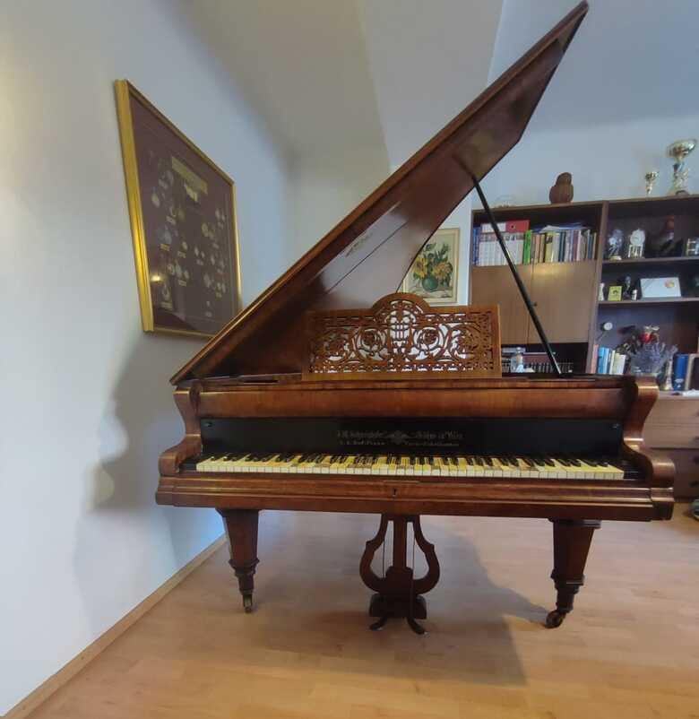 230 years old baby grand piano