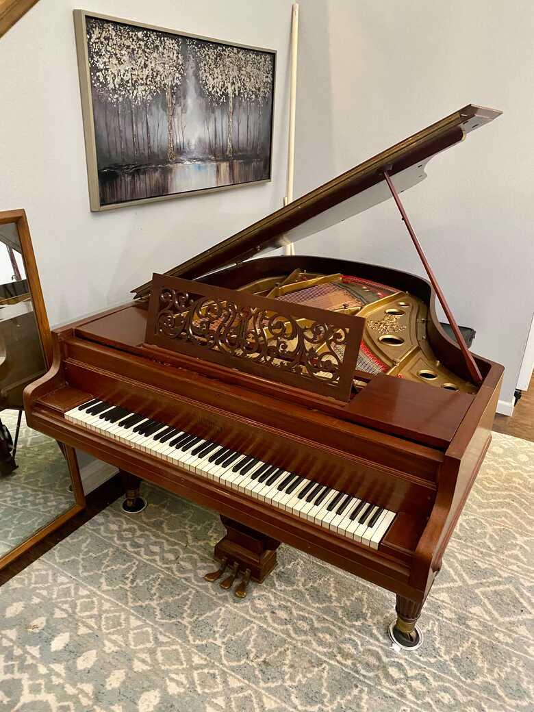 Antique Chickering Grand Piano