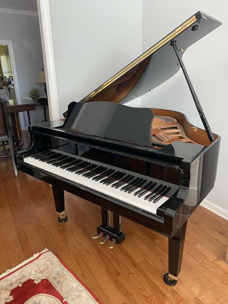 Immaculate Yamaha baby grand piano GP1