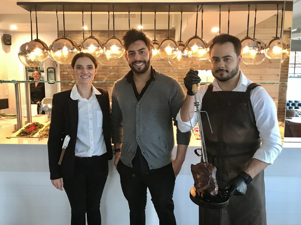 Co-owner Thiago Machado, restaurant manager, Stephanie Carvalho, and chef at Golden Bull Brazilian Steakhouse Vineyard Haven Martha's Vineyard New for 2019