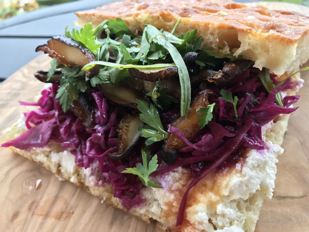Katama General Store Martha's Vineyard Featured Lunch Sanwich The Shroom - made with shiitake mushrooms from MV Mycological, pickled red cabbage, housemade ricotta, with a drizzle of honey on housemade focaccia