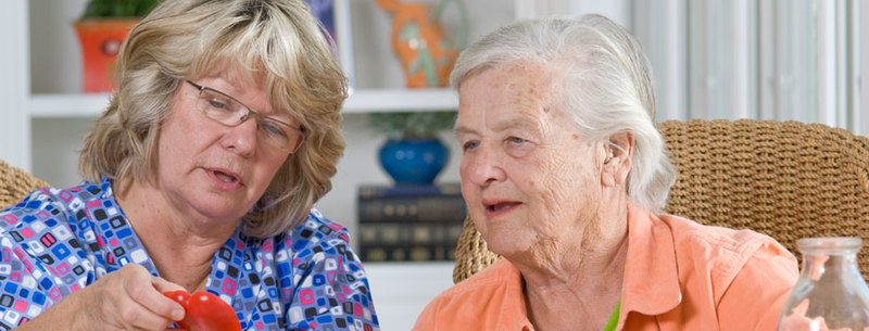 Caregiver helping senior client