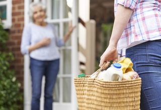 Socially-Distanced Grocery Shopping and Delivery to Older Adults