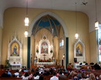Holy_Family_Catholic_Church__Oldenburg__Indiana__-_interior__nave_before_a_wedding_Mass.jpg