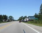 Rapid_River_Michigan_Sign_Looking_West_US2.jpg