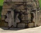 Threshing_stone_cross_section__Santa_Fe_Park__Peabody__Kansas.jpg