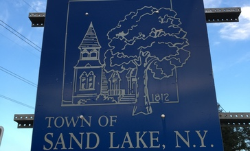 2015-08-20_19_36_19__Welcome_to_the_Town_of_Sand_Lake__sign_along_eastbound_New_York_State_Route_43__West_Sand_Lake_Road__entering_Sand_Lake__New_York_from_North_Greenbush__New_York.jpg