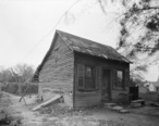 Photograph_of_1936_of_a_Cabin_Behind_the_Amoureaux_House_in_Ste_Genevieve_MO.jpg