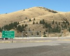 Road_sign_at_junction_of_US_Route_93_and_Montana_Highway_200_at_Ravalli__Montana.jpg