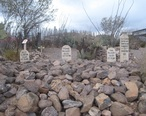 Tombstone-Boot_Hill_Graveyard-Graves_of_Billy_Clanton__and_Frank_and_Tom_McLaury_2.jpg