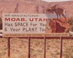 County-sponsored_sign_promoting_manufacturing_in_Moab_during_the_early_1970s.jpg