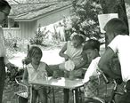 Children_selling_lemonade_to_an_adult_in_La_Canada__California__1960.jpg