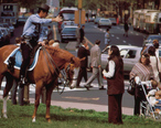 MOUNTED_POLICEMAN_ON_BUSY_DOWNTOWN_THOROUGHFARE_-_NARA_-_552732_b.jpg