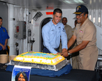 US_Navy_091008-N-9761H-041_Vice_Adm._D.C._Curtis_and_Intelligence_Specialist_3rd_Class_Ryan_Paigo_cut_a_cake_during_a_ceremony_in_observance_of_Hispanic_American_Heritage_Month.jpg