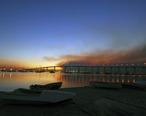 US_Navy_071023-N-5491S-001_The_sun_rises_over_the_Coronado_Bay_Bridge_with_smoke_from_the_Harris_fire_looming_overhead.jpg