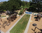 Aerial_view_of_Hap_Magee_Ranch_Park_showing_childrens_playground_in_the_foreground__picnic_area_on_the_left_and_park_area_in_the_background.JPG
